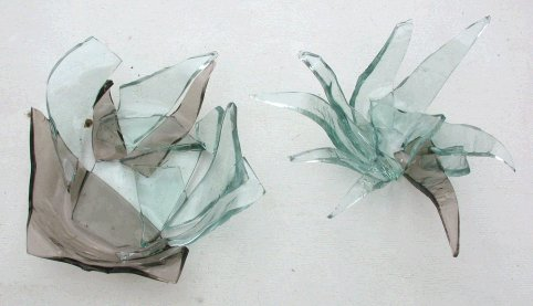Fused bowls from broken thick window glass.