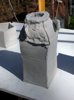 Square bottle mold with neck molds perched on top after kiln prefiring (1450F)