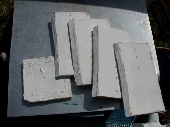 Square clay mold broken apart from pressure of glass and weak joints