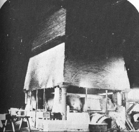 Interior of glass house showing furnace and air flow control