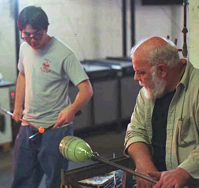Hugh Irwin and son working a piece at Hickory Street Hot Glass, placing the punty.