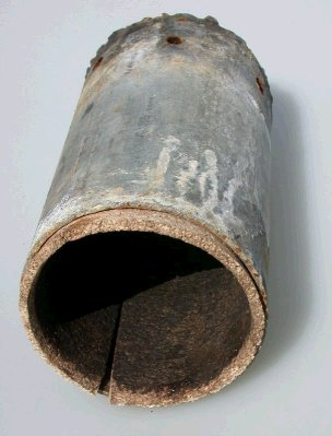 Cork lined steel tube with bottom for blowing cylinders